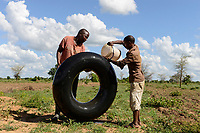 ZAMBIA, Mazabuka, Chikankata area, farm of medium scale farmer Stephen Chinyama, patching a flat tube of a tractor  tire at the field