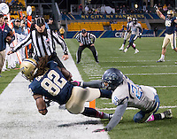 Pitt tight end Manasseh Garner scores on a 21-yard touchdown catch. The Pitt Panthers defeated the Old Dominion Monarchs 35-24 at Heinz Field, Pittsburgh, Pennsylvania on October 19, 2013.