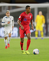 WASHINGTON, D.C. - OCTOBER 11: Reggie Cannon #20 of the United States looks downfield for an open man during their Nations League game versus Cuba at Audi Field, on October 11, 2019 in Washington D.C.