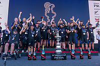 17th March 2021; Waitemata Harbour, Auckland, New Zealand;  Emirates Team New Zealand on stage being presented with the Americas Cup on stage after beating Luna Rossa Prada Pirelli Team 7 - 3. Glen Ashby pours for Peter Burling.  Wednesday the 17th of March 2021.