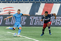 FOXBOROUGH, MA - SEPTEMBER 02: Alexander Ring #8 of New York City FC takes a shot as Michael Mancienne #13 of New England Revolution closes during a game between New York City FC and New England Revolution at Gillette Stadium on September 02, 2020 in Foxborough, Massachusetts.