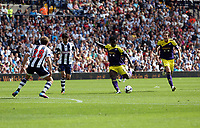 Sunday 01 September 2013<br /> Pictured: Wilfried Bony of Swansea (3rd L) takes a shot off tarket, while marked by Billy Jones (28) and Claudio Yacob of West Brom, his team mate Michu (R) is screaming for a pass. <br /> Re: Barclay's Premier League, West Bromwich Albion v Swansea City FC at The Hawthorns, Birmingham, UK.