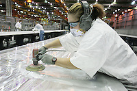 A Boeing employee sands a wing at the Skin and Spar Factory in Frederickson, Washington.