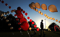 Kelly.Jordan@jacksonville.com--102513--Students set up balloons for the players to run through during pre-game festivities as Harvest Community School takes on Cedar Creek Christian High School at Greenland Park Friday night October 25, 2013 in Jacksonville, Florida.(The Florida Times-Union, Kelly Jordan)