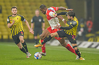 Uche Ikpeazu of Wycombe Wanderers (centre) and Kiko Femenía of Watford during the Sky Bet Championship behind closed doors match between Watford and Wycombe Wanderers at Vicarage Road, Watford, England on 3 March 2021. Photo by David Horn.
