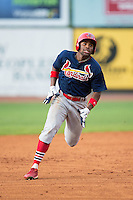 Malik Collymore (15) of the Johnson City Cardinals legs out a triple against the Bristol Pirates at Boyce Cox Field on July 7, 2015 in Bristol, Virginia.  The Cardinals defeated the Pirates 4-1 in game one of a double-header. (Brian Westerholt/Four Seam Images)