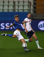 Footbal Soccer: FIFA World Cup Qatar 2022 Qualification, Italy - Northern Ireland, Ennio Tardini stadium, Parma, March 26, 2021.<br /> Italy's Ciro Immobile (L) in action with Northern Ireland Craig Cathcart (R) during the FIFA World Cup Qatar 2022 qualification, football match between Italy and Northern Ireland, at Ennio Tardini stadium in Parma on March 26, 2021.<br /> UPDATE IMAGES PRESS/Isabella Bonotto