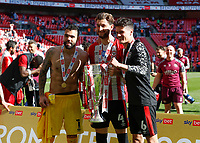 29th May 2021; Wembley Stadium, London, England; English Football League Championship Football, Playoff Final, Brentford FC versus Swansea City; Goalkeeper David Raya, Charlie Goode and Christian Norgaard of Brentford pose with the Sky Bet EFL Championship Plays-off Trophy after they won 2-0 and promoted to the premier league
