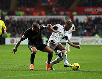 Wednesday, 01 January 2014<br /> Pictured: Wayne Routledge of Swansea (R) is challenged by a Manchester city player.<br /> Re: Barclay's Premier League, Swansea City FC v Manchester City at the Liberty Stadium, south Wales.