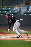 Lansing Lugnuts shortstop Yeltsin Gudino (5) follows through on a swing during a game against the Clinton LumberKings on May 9, 2017 at Ashford University Field in Clinton, Iowa.  Lansing defeated Clinton 11-6.  (Mike Janes/Four Seam Images)