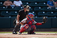 Hickory Crawdads catcher David García (13) sets a target as home plate umpire Hector Cuellar looks on during the game against the Winston-Salem Dash at Truist Stadium on July 10, 2021 in Winston-Salem, North Carolina. (Brian Westerholt/Four Seam Images)