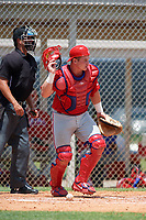 GCL Phillies catcher Kipp Moore (3) and home plate umpire Clay Williams during a game against the GCL Tigers East on July 25, 2017 at TigerTown in Lakeland, Florida.  GCL Phillies defeated the GCL Tigers East 4-1.  (Mike Janes/Four Seam Images)