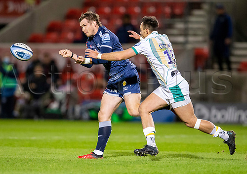 20th November 2020; AJ Bell Stadium, Salford, Lancashire, England; English Premiership Rugby, Sale Sharks versus Northampton Saints; AJ Macginty of Sale Sharks passes the ball before being tackled by Tom Collins of Northampton Saints