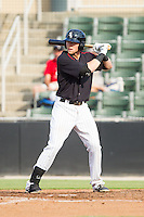 Trey Michalczewski (27) of the Kannapolis Intimidators at bat against the Asheville Tourists at CMC-NorthEast Stadium on July 13, 2014 in Kannapolis, North Carolina.  The Tourists defeated the Intimidators 8-2.  (Brian Westerholt/Four Seam Images)