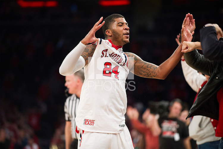 NEW YORK, NY - Sunday December 13, 2015: Ron Mvouika (#24) of St. John's celebrates defeating Syracuse 84-72 during the NCAA men's basketball regular season at Madison Square Garden in New York City.