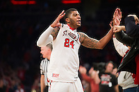 NEW YORK, NY - Sunday December 13, 2015: Ron Mvouika (#24) of St. John's celebrates defeating Syracuse 84-72 during the NCAA men's basketball regular season at Madison Square Garden in New York City.