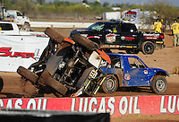 Apr 17, 2011; Surprise, AZ USA; LOORRS driver Myan Spaccarelli (12) flips over during round 4 at Speedworld Off Road Park. Mandatory Credit: Mark J. Rebilas-