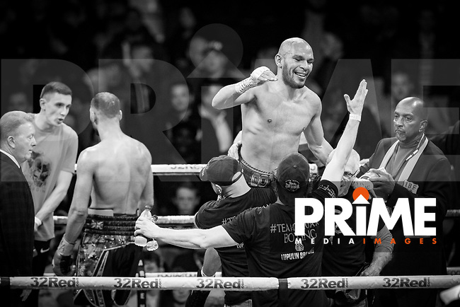 Caleb Truax celebrates as he is crowned the new Champions after a points decision - THE IBF WORLD SUPER-MIDDLEWEIGHT CHAMPIONSHIP 12 X 3 Minute Rounds JAMES DeGALE MBE 12st V CALEB TRUAX 11st 13lbs during the Boys are back in town - Frank Warren Boxing event at the Copper Box Arena, London, England on 9 December 2017. Photo by Andy Rowland.