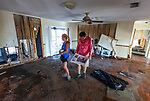 PORT SAINT JOE, FL - OCTOBER 14: Pastor Geoffrey Lentz, right, and his wife Liz looks continue to salvage personal property as they walk through their home next to the First United Methodist Church that was gutted by the storm surge from Hurricane Michael on October 14, 2018 in Port Saint Joe, Florida.  (Photo by Mark Wallheiser/Getty Images)