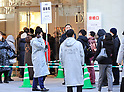 """Shoppers queue to purchase """"lucky bags"""""""
