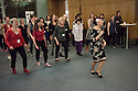London, UK. 23.02.2015. A Lindy Hop dance class is held at Portcullis House, Westminster, hosted by DanceUK, with MPs as guests, to launch the Dance Manifesto.  Strictly's Jenny Thomas and Robin Windsor teach the class, whilst Bic Graham, from The Lindy Club,  DJs. Picture shows: Jenny Thomas (Strictly Come Dancing Choreographer) teaching Dancers and MPs some basic steps. Photograph © Jane Hobson.