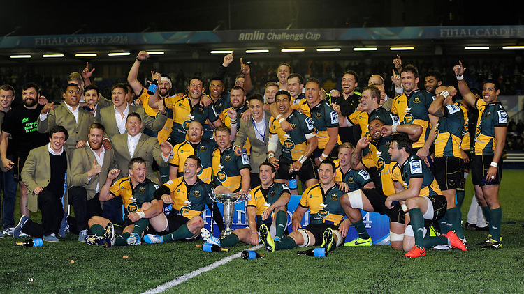 Northampton Saints celebrate winning the Amlin Challenge Cup trophy after beating Bath Rugby 16-30 at Cardiff Arms Park on Friday 23rd May 2014 (Photo by Rob Munro)