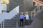 Senior couple walking upstairs in Denver, Colorado. .  John offers private photo tours in Denver, Boulder and throughout Colorado. Year-round Colorado photo tours.