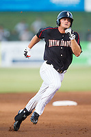 Adam Engel (23) of the Kannapolis Intimidators hustles towards third base after hitting a triple against the Delmarva Shorebirds at CMC-NorthEast Stadium on July 2, 2014 in Kannapolis, North Carolina.  The Intimidators defeated the Shorebirds 6-4. (Brian Westerholt/Four Seam Images)