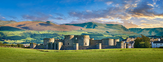 Beaumaris Castle, looking towards Snowdonia,  built in 1284 by Edward 1st, considered to be one of the finest example of 13th century military architecture by UNESCO. A Unesco World Heritage Site. Beaumaris, Anglesey Island, Wales.