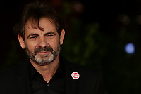 """Open Arms founder Oscar Camps poses on the 16th International Rome Film Fest (Festa del Cinema di Roma) red carpet for the movie of the film """"Mediterraneo: The Law of The Sea  """" on October 15, 2021 at the Auditorium Parco della Musica in Rome.<br /> UPDATE IMAGES PRESS/Isabella Bonotto"""