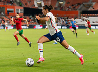 HOUSTON, TX - JUNE 10: Carli Lloyd #10 of the USWNT sprints downfield during a game between Portugal and USWNT at BBVA Stadium on June 10, 2021 in Houston, Texas.