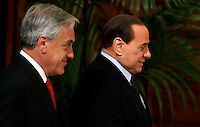 Il Presidente del Consiglio Silvio Berlusconi, a destra, accoglie il Presidente della Repubblica del Cile Sebastian Pinera a Palazzo Chigi, Roma, 2 marzo 2011..Italian Premier Silvio Berlusconi, right, welcomes Chilean President Sebastian Pinera, at Chigi Palace, Rome, 2 march 2011..UPDATE IMAGES PRESS/Riccardo De Luca