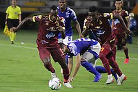 IBAGUE - COLOMBIA, 06-10-2020: Juan Fernando Caicedo del Tolima disputa el balón con Matias de los Santos de Millonarios durante partido entre Deportes Tolima y Millonarios por la fecha 12 de la Liga BetPlay DIMAYOR 2020 jugado en el estadio Manuel Murillo Toro de la ciudad de Ibagué. / Juan Fernando Caicedo of Tolima vies for the ball with Matias de los Santos of Millonarios during match between Deportes Tolima and Millonarios for the date 12 as part BetPlay DIMAYOR League 2020 played at Manuel Murillo Toro stadium in Ibague city.  Photo: VizzorImage / Juan Torres / Cont