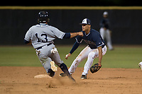 AZL Padres 2 second baseman Sean Guilbe (10) covers the bag on a stolen base attempt by Jawuan Harris (13) during an Arizona League game against the AZL Padres 1 at Peoria Sports Complex on July 14, 2018 in Peoria, Arizona. The AZL Padres 1 defeated the AZL Padres 2 4-0. (Zachary Lucy/Four Seam Images)