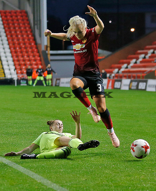 Alex Greenwood of Manchester United Women leaps over Jade Pennock of Sheffield Utd Women