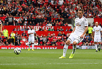 Pictured: Gylfi Sigurdsson of Swansea.  Saturday 16 August 2014<br /> Re: Premier League Manchester United v Swansea City FC at the Old Trafford, Manchester, UK.