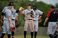 Edgewood Eagles starting pitcher Ryan Fields (9) fist bumps shortstop Max Orput during the second game of a double header against the Bethel Wildcats on March 15, 2019 at Terry Park in Fort Myers, Florida.  Bethel defeated Edgewood 3-2.  (Mike Janes/Four Seam Images)