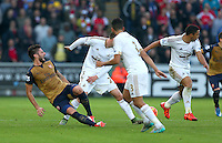 Olivier Giroud of Arsenal suffers an injury from this challenge late in the first half but comes back on shortly after during the Barclays Premier League match between Swansea City and Arsenal played at The Liberty Stadium, Swansea on October 31st 2015