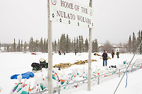 Top teams rest on straw in the baseball diamond at Nulato on Saturday afternoon during the 2008 Iditarod