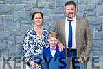 Liam Kearney who received his First Holy Communion in Kilmoyley on Saturday standing with his mom and dad Helen and Thomas Kearney.
