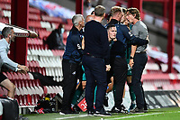 Connor Roberts of Swansea City clashes with Thomas Frank Manager of Brentford during the Sky Bet Championship Play Off Semi-final 2nd Leg between Brentford and Swansea City at Griffin Park in Brentford, England, UK. 29th July, 2020
