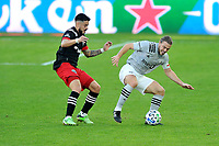 WASHINGTON, DC - NOVEMBER 8: Samuel Piette #6 of Montreal Impact battles for the ball with Junior Moreno #5 of D.C. United during a game between Montreal Impact and D.C. United at Audi Field on November 8, 2020 in Washington, DC.