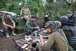 UKRAINE, Shyrokyne: the platoon of the battalion Donbass on the first line of defense is having a rest under the rain.  <br /> <br /> UKRAINE, Shyrokyne: le peloton du bataillon Donbass prend une pause sous la pluie sur la première ligne de défense.
