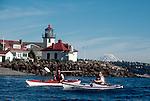 Sea Kayakers, Seattle, Mount Rainier, sea kayaking couple paddle past Alki Point, West Seattle, Washington State, Puget Sound, Pacific Northwest, USA,.