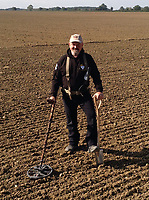 BNPS.co.uk (01202 558833)<br /> Pic: DNW/BNPS<br /> <br /> He's in the money - Detectorist Don Crawley from Suffolk.<br /> <br /> A builder is celebrating today after unearthing an enormous hoard of silver coins worth £50,000.<br /> <br /> Don Crawley was searching Suffolk farmland with his metal detector when he stumbled upon the buried treasure.<br /> <br /> He dug up 99 silver coins - 81 pennies and 18 cut halfpennies - all dating back to Anglo Saxon England and the reign of King Ethelred II from 978-1016AD.