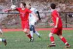 WINSTED CT. - 17 November 2020-111720SV07-#17 Josh Boucher of Northwestern stops a ball as #16 Harry Sanders of Housatonic defends during Berkshire League boy's soccer tournament action in Winsted Tuesday.<br /> Steven Valenti Republican-American