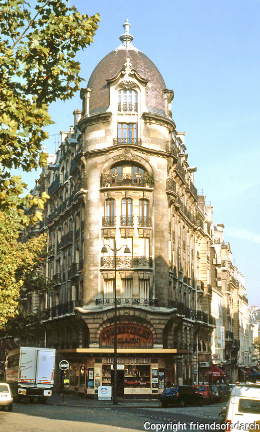 Paris: Corner building--Parisian vernacular. Blvd. Raspail and Rue Brea.