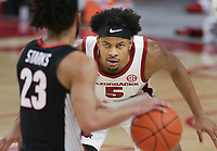 Arkansas guard Moses Moody (5) blocks Georgia Mikal Starks (23), Saturday, January 9, 2021 during the first half of a basketball game at Bud Walton Arena in Fayetteville. Check out nwaonline.com/210110Daily/ for today's photo gallery. <br /> (NWA Democrat-Gazette/Charlie Kaijo)