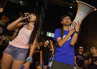 Students are seen addressing the crowd outside the Hong Kong government offices on the second day of the mass civil disobedience campaign Occupy Hong Kong, Admiralty, China, 30 September 2014. The movement is also being dubbed the 'umbrella revolution' after the versatile umbrellas used to shield protesters from rain, sun - and police pepper spray.