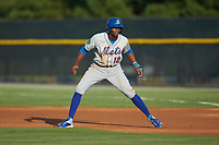 Shervyen Newton (12) of the Kingsport Mets takes his lead off of first base against the Burlington Royals at Burlington Athletic Stadium on July 27, 2018 in Burlington, North Carolina. The Mets defeated the Royals 8-0.  (Brian Westerholt/Four Seam Images)